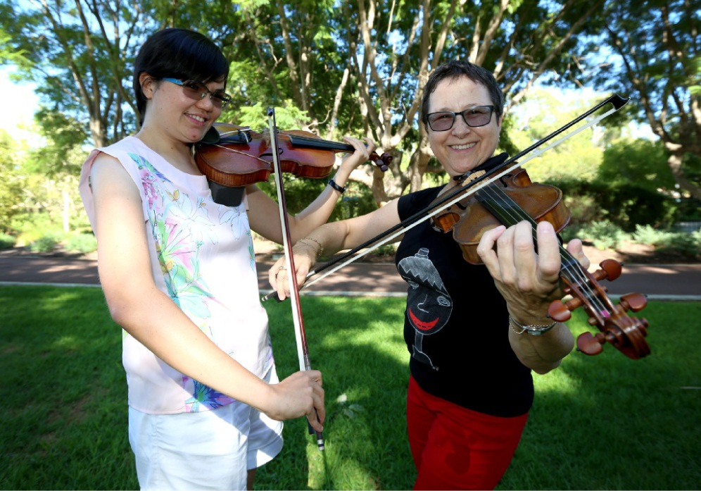 Orchestra members Elise Rosenberg and Ronniet Orlando.d449680