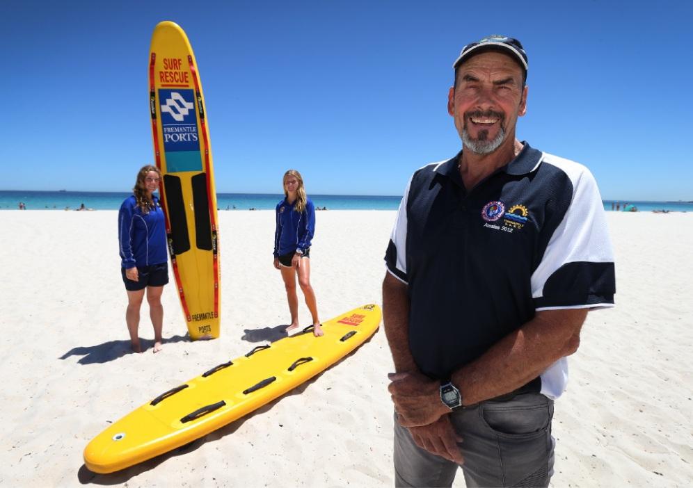 Lifesavers Maddie Shaw and Tully Jackson and Swim Thru co-ordinator Colin Duffield. Picture: Matt Jelonek    d449471