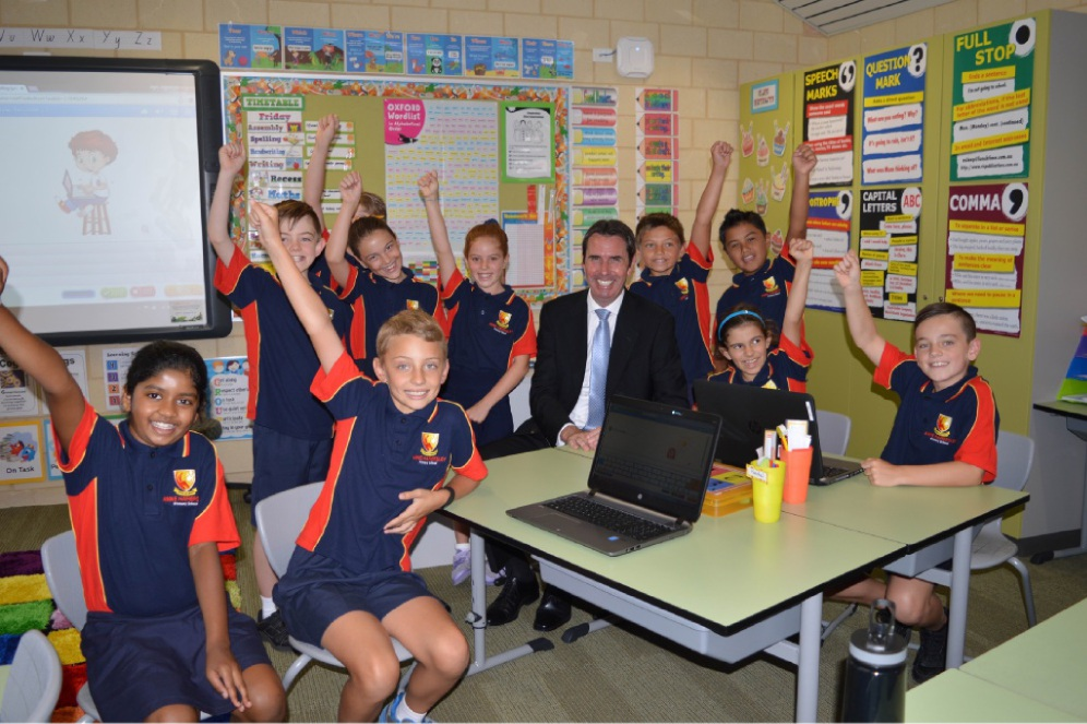Education Minister Peter Collier with students at the opening of Anne Hamersley Primary School.