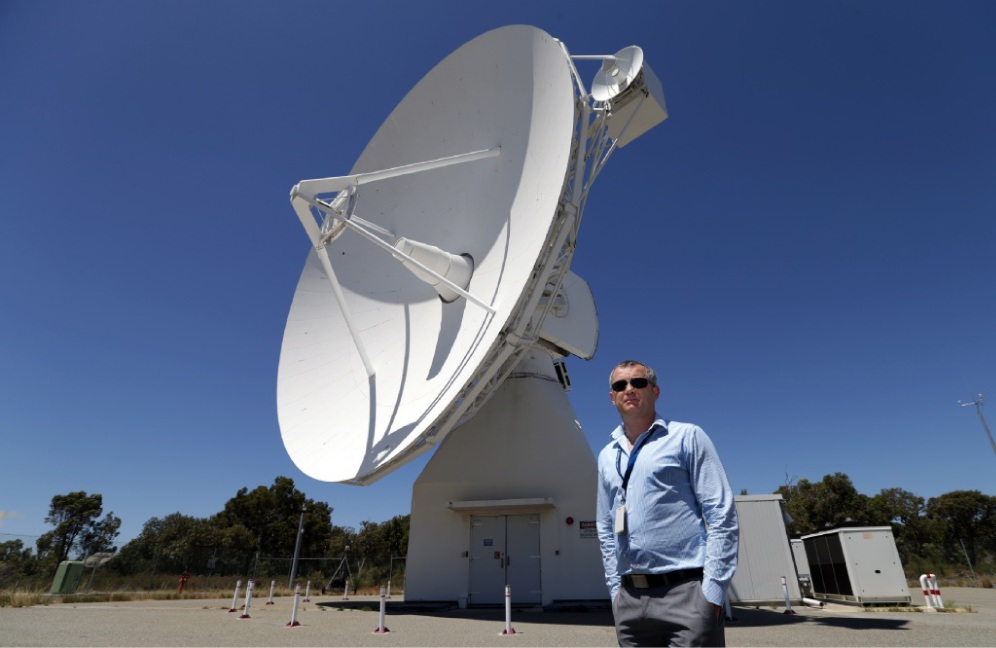 ESA maintenance and operations supervisor Colin Cassidy with the 15-metre antenna. Picture: Martin Kennealey www.communitypix.com.au d449501