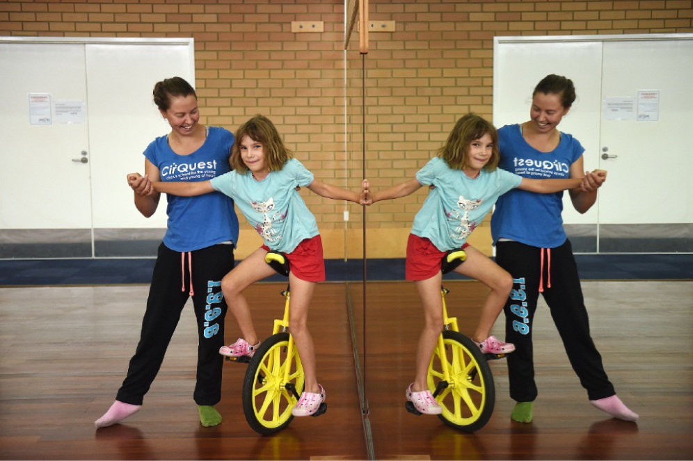 Natasha Wind, from CirQuest, helps Lilla Kovalcsic balance on a unicyle. Picture: Jon Hewson        www.communitypix.com.au   d449120