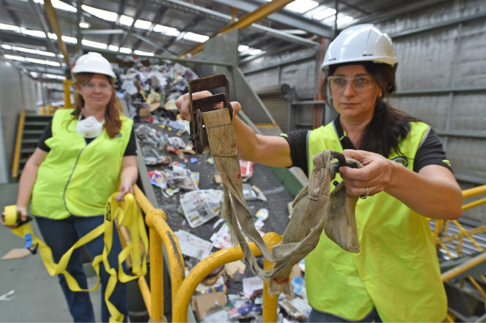 SMRC education officer Emma Baker and community engagement and communications officer Taryn Davis show the tie-down straps that are causing problems at the plant. Picture: Jon Hewson        www.communitypix.com.au   d449340