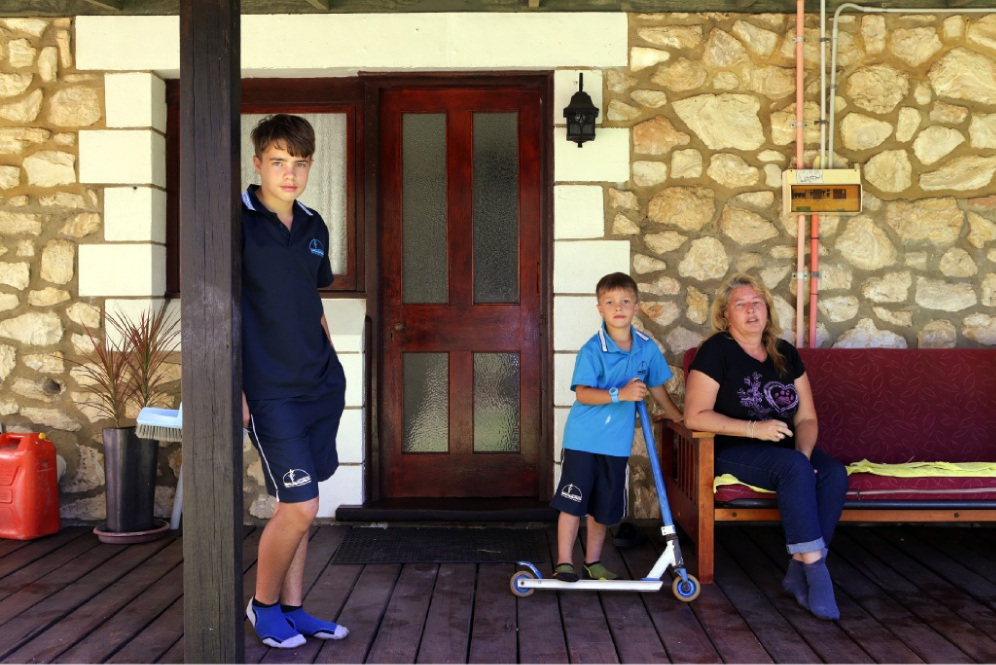 Kaylene Cartledge, of Woodridge, with her sons Nathan (14) and Julian (5). Picture: Martin Kennealey d449445