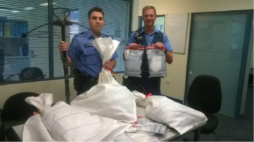 Belmont police first-class constables Luke Gobby and Andy May with some of the illegal items found during the recent searches.