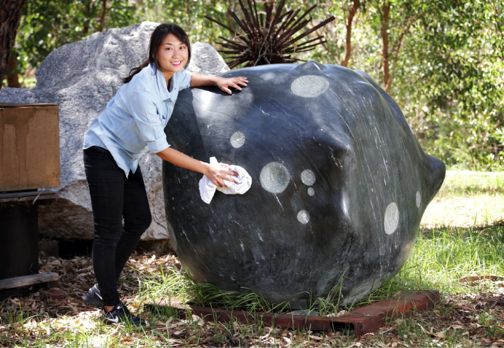 Jina Lee with her Sculpture by the Sea entry Meteorite.       Picture: David Baylis www.communitypix.com.au   d449349