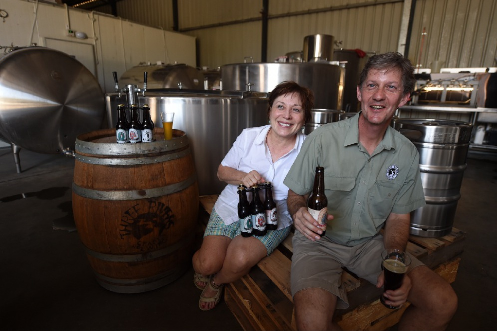 Trina Youchak and  Mark Rivers  in their brewery and (below) Mark at the door. Picture: Jon Hewson        www.communitypix.com.au   d449183