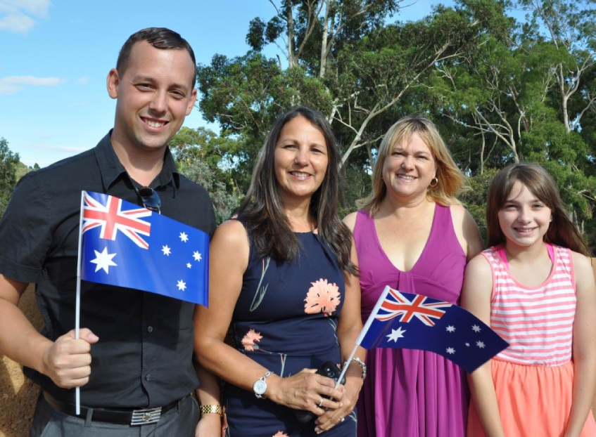 Shire of Mundaring President David Lavell with Citizenship Award for a person under 25 years winner Richard Lambert and nominees Kelly Goodman, Cerys Bell-Bedlow and Shannon Pass. New Australian citizen Laura Fischer (second from left) with her family.