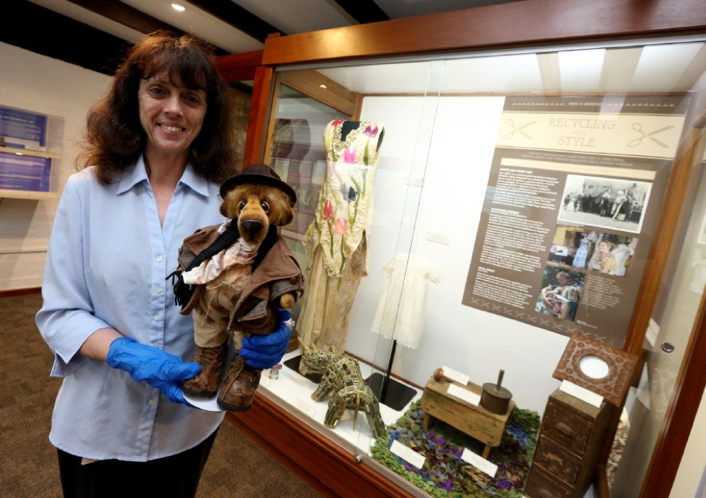 Museum education officer Hazel James with Mr Bojangles, made by local resident Kay Cooper.