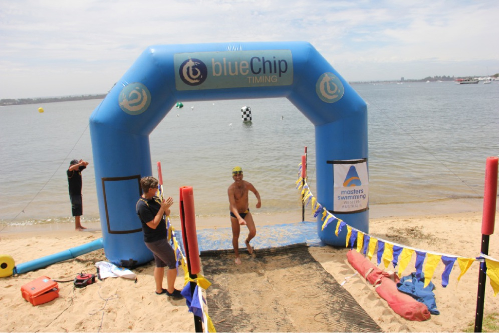 Brett Silvester crosses the finish line at the 97th annual Swim Thru Perth.