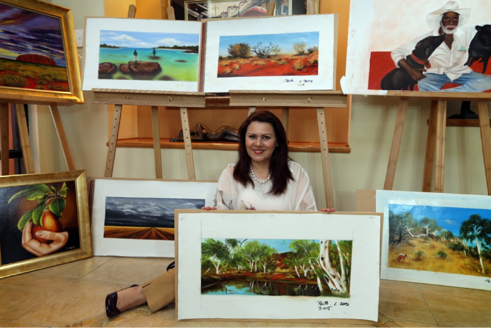 Mindarie artist Ljubica Ratz with a selection of her works she will exhibit in Serbia. Picture: Martin Kennealey        www.communitypix.com.au   d448080