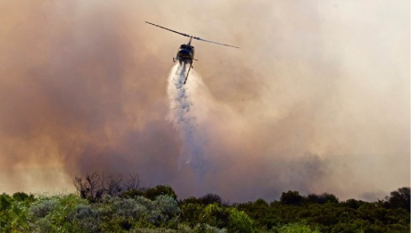 A water bomber douses the flames. Picture: Peter Walpole