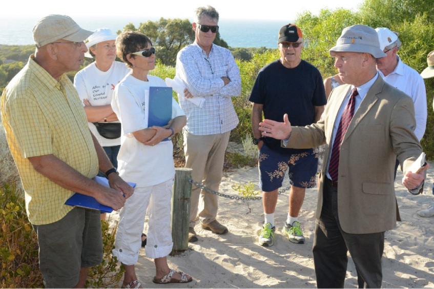 Lt-Gen Mark Evans (in tie) discussing with residents and environmentalists on Melon Hill the impact of Seaward Village redevelopment last Tuesday. Picture: Jon Bassett