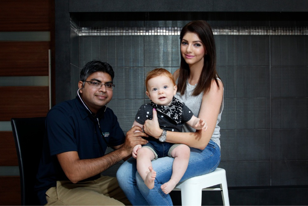 Doctor Sajid Qamar with patient Chase and mum Hayley Zammar. Picture: Marie Nirme           www.communitypix.com.au d448514
