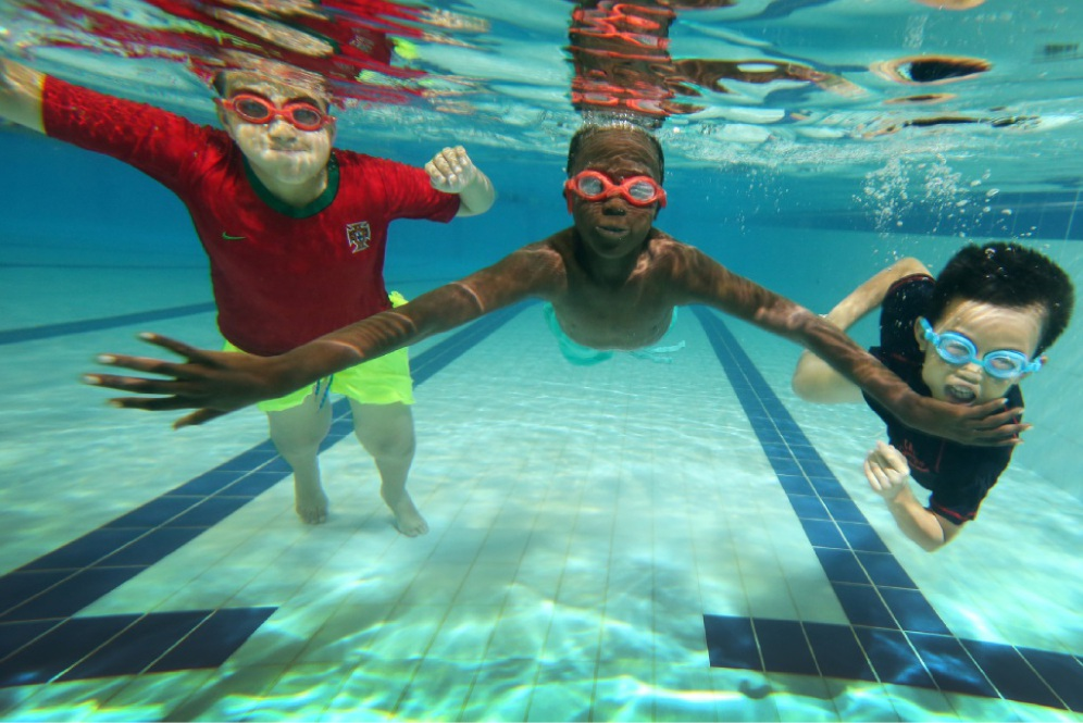 Allan Divania (9), John Laki (9) and Ryan Amuro Yung (7) at the swimming program. Picture: Andrew Ritchie        www.communitypix.com.au   d448534