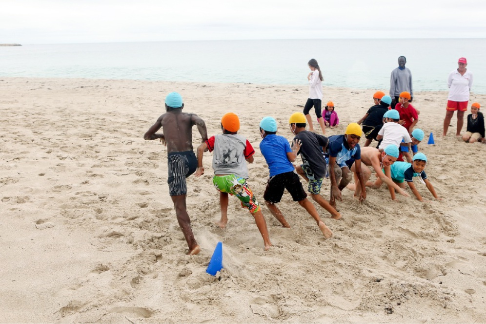 Swimming and beach safety workshops are being held for multicultural children.