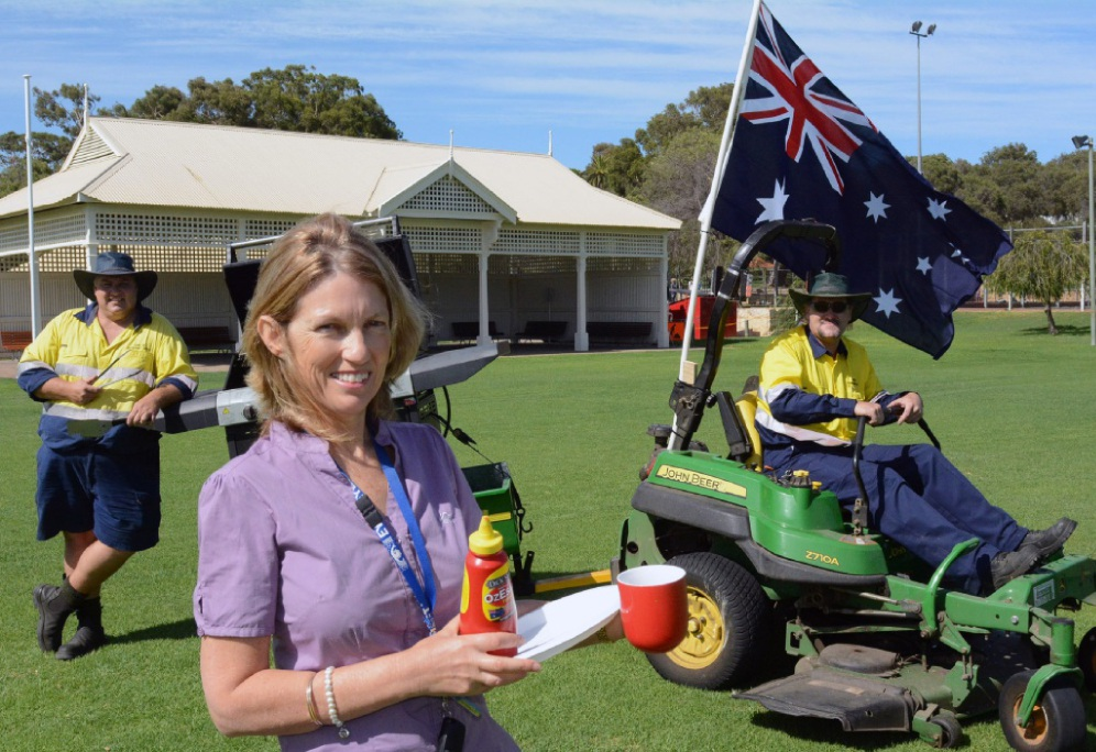 Community development officer Vanessa O'Brien, council mower driver Rob Young and groundsman Paul English prepare for the Australia Day breakfast.  Picture: Jon Bassett