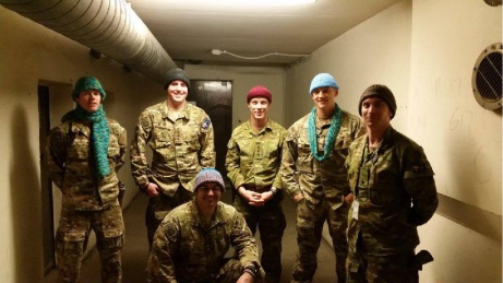 Australian troops providing logistical support in Afghanistan with the scarves and beanies sent by RSLWA.