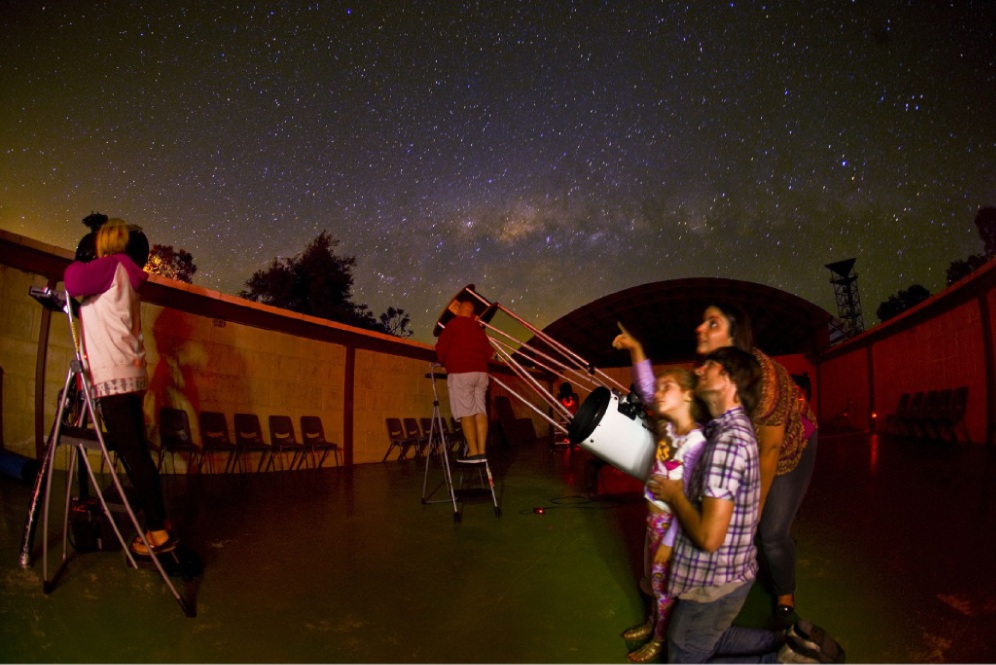 Visitors gaze at the night sky.