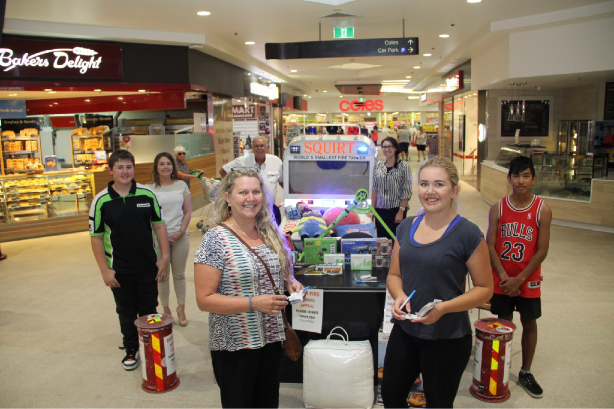 Back, from the left: Lachlan Billiard (14), Warnbro Centre manager Alison Broadbent, Laurie Drage and Warnbro Centre marketing manager Taryn Palermo. Front, from the left: shoppers Annabelle and Rebekah Gradussov and Suriyou Leigh Sandrini (15).