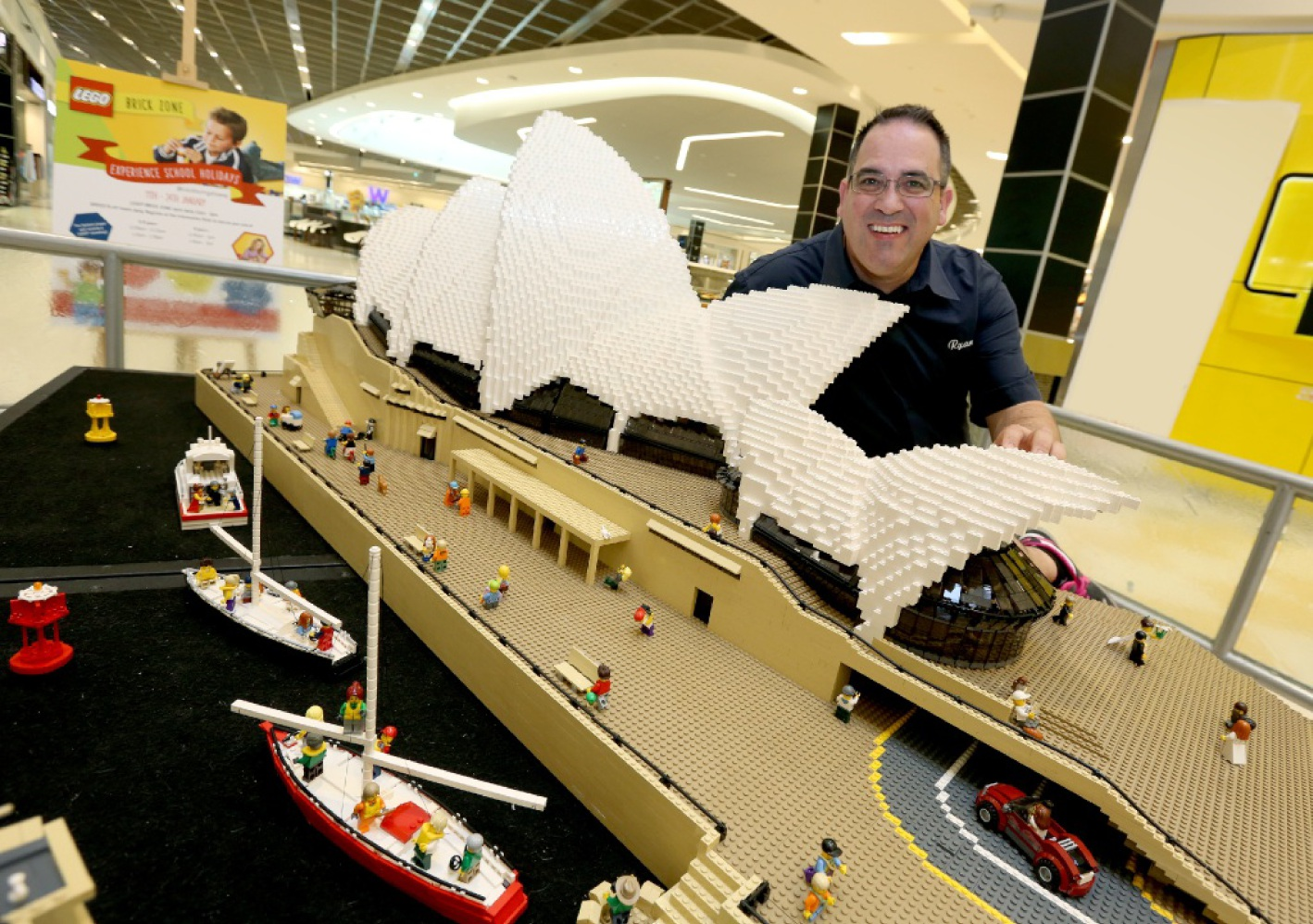 Lego professional Ryan 'The Brickman' McNaught with a model of the Sydney Opera House at the Cockburn Gateway exhibit.  Picture: Matt Jelonek        www.communitypix.com.au   d448473
