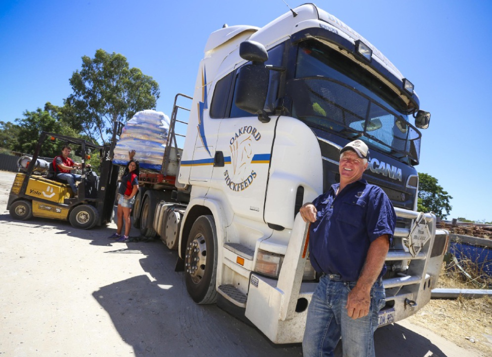 Oakford Stockfeeds staff Dylan Llewellyn and Cindy Imhof and driver Ray Sedgwick |prepare a load of donated feed for transport. Picture: Matt Jelonek        d448666