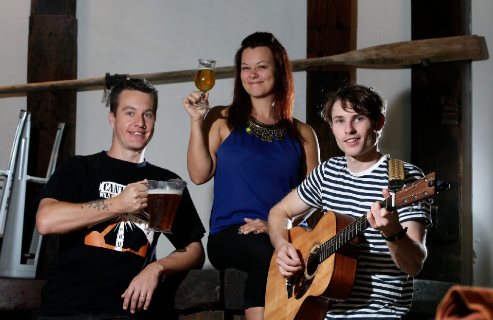 The Dutch Trading Company's owner Joel Beresford (left) with acoustic duo Beth & Col (Beth Kuwertz and Colin Outhwaite). Picture: Marie Nirme d448555