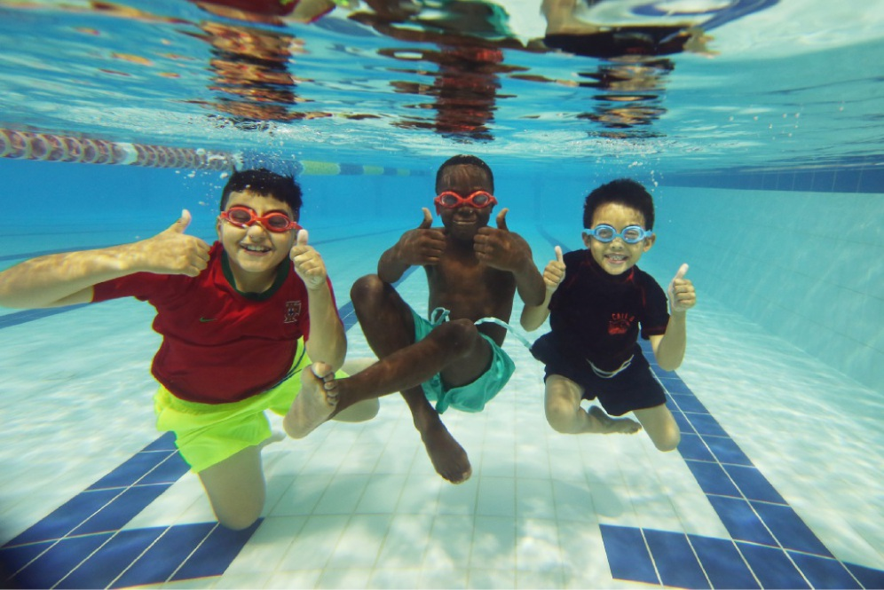 Confident in the water: Allan Divania (9), John Laki (9) and Ryan Amuro Yung (7). Picture: Andrew Ritchie    d448534