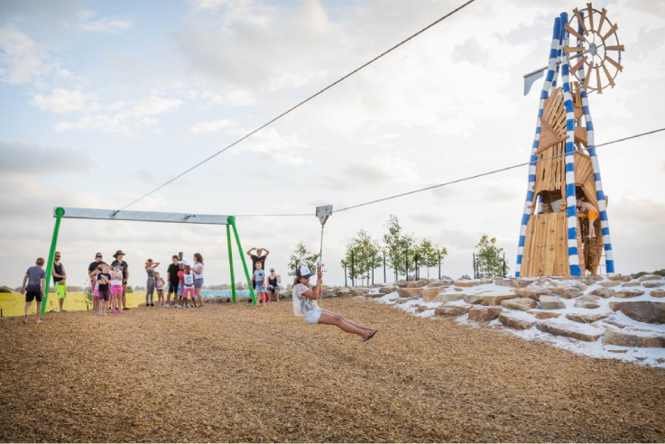 Above: The park features a 35m flying fox. Top: Hundreds of children enjoyed the new park.