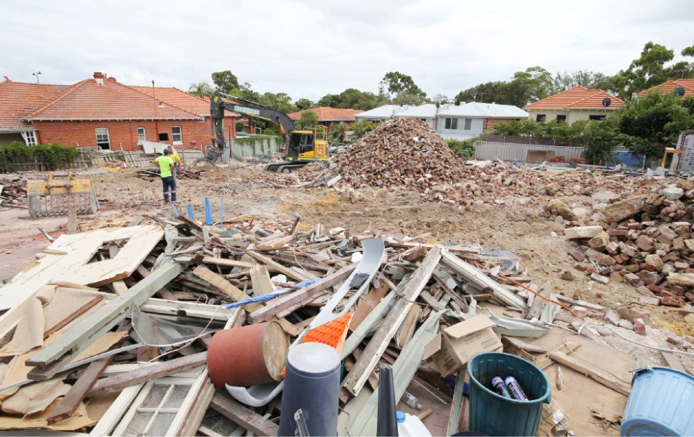 Centuries-old houses are being demolished for a new learning centre. Picture: David Baylis    d448509