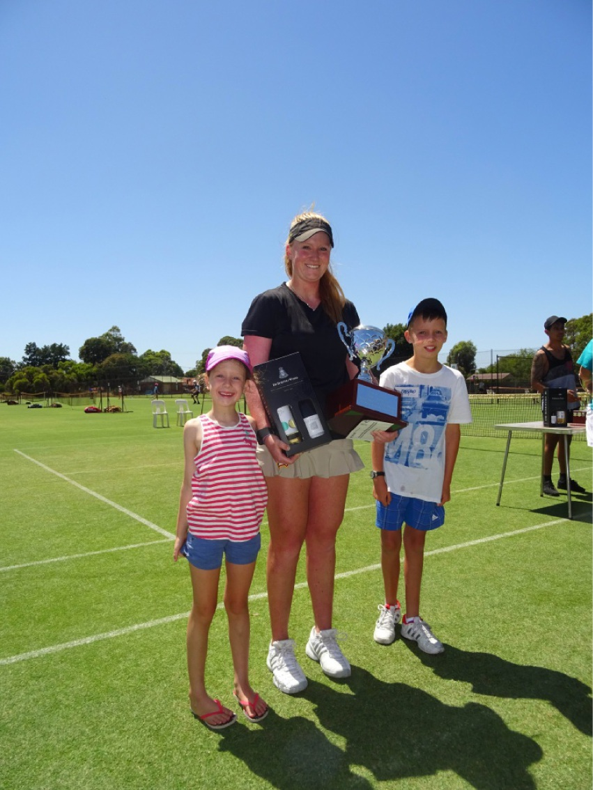 Caitlin Cridland shows off her trophies with her siblings Matilda (7) and Jimmy (10).