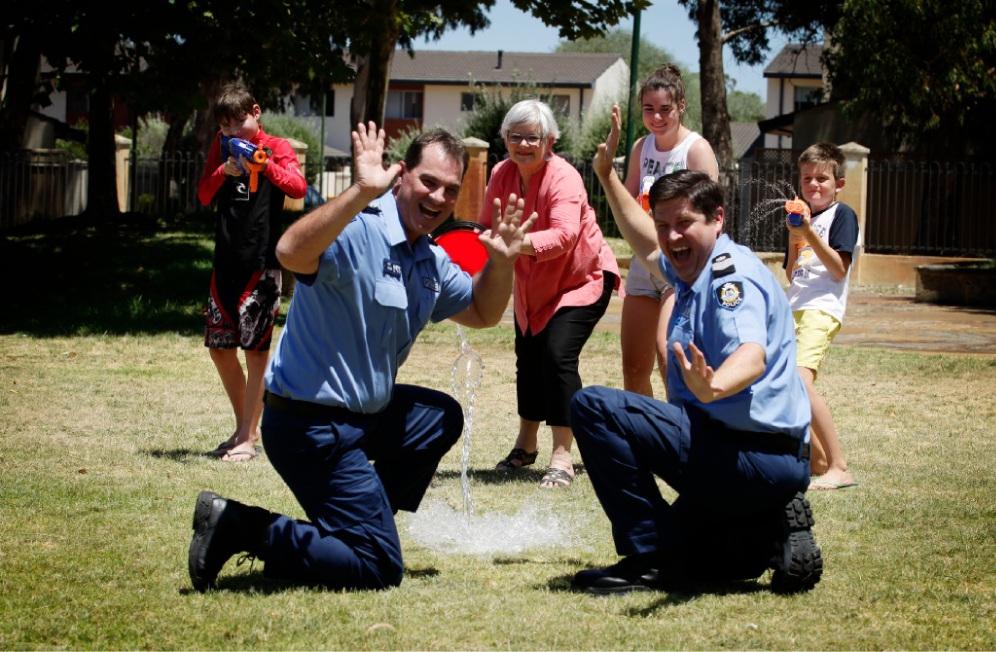 Kensington police officers Ash Goy (left) and Craig O'Hehir have a bucket of fun with, from left, Lachlan Appleby, South Perth Mayor Sue Doherty, Georgia Appleby and Charlie King. Picture: Marie Nirme           d448382