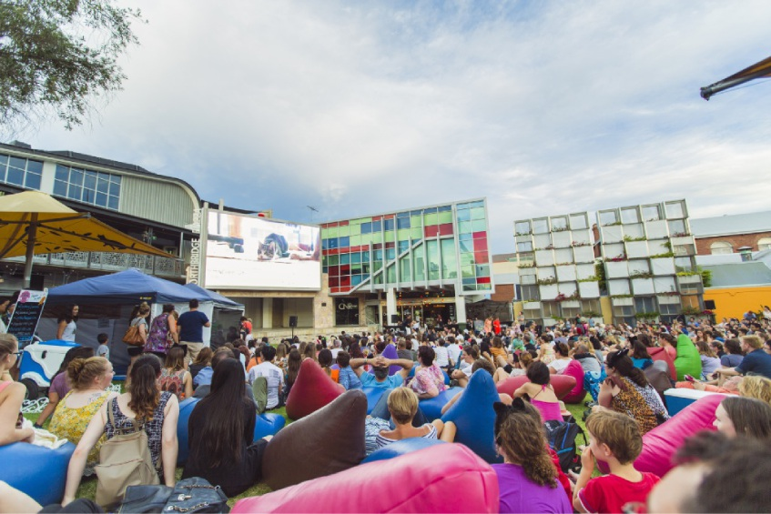Cheryl Har and Bronwyn Mory got into the spirit of last year's Internet Cat Video Festival. Pictures: Mac1 Photography The crowd at last year's festival enjoys a cat video on the piazza's big screen.