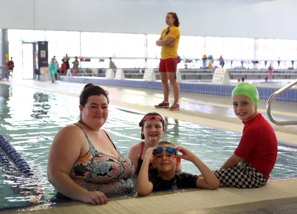 CJ Smith with her children James (9), Annabelle (10) and Elijah (7) enjoy a swim at Cannington Leisureplex.