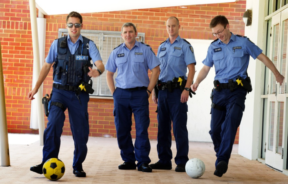 Constable Joe Blay,Sergeant Andy Abel,Constable Tate and 1st Class Constable Dean Walker practise their soccer skills in readiness for the friendly game. Picture: Martin Kennealey www.communitypix.com.au   d448387