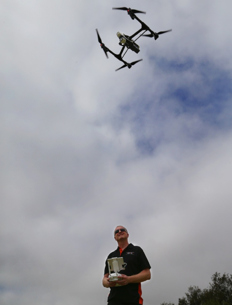 John Keyworth flies one of his drones. Picture: Martin Kennealey        www.communitypix.com.au   d448264