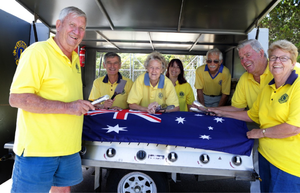 Unflagging devotion: Lions Club of Duncraig members Bill Hildebrand, Geoff O'Brien, Toni Whiteaker, Emma Boyes, Jim Godden, Rob Meney and Helen Montgomery. Picture: Martin Kennealey         www.communitypix.com.au   d448505
