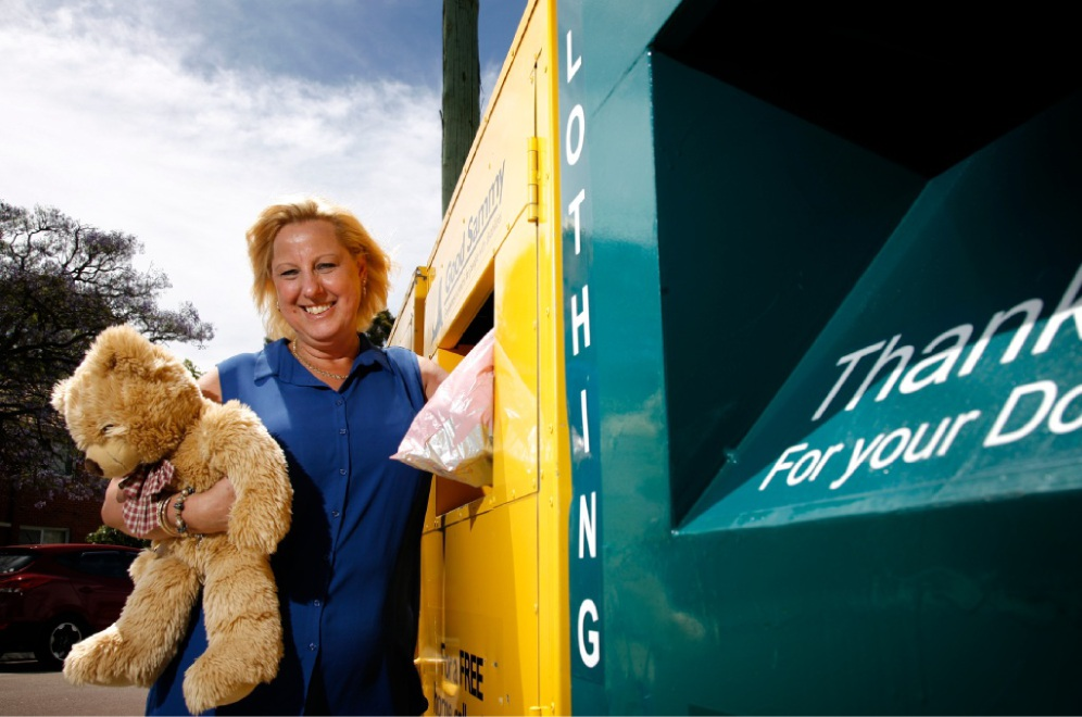 Debbie Cameron, from Good Samaritan Industries, at charity bins in Kensington. Picture: Marie Nirme        d446316