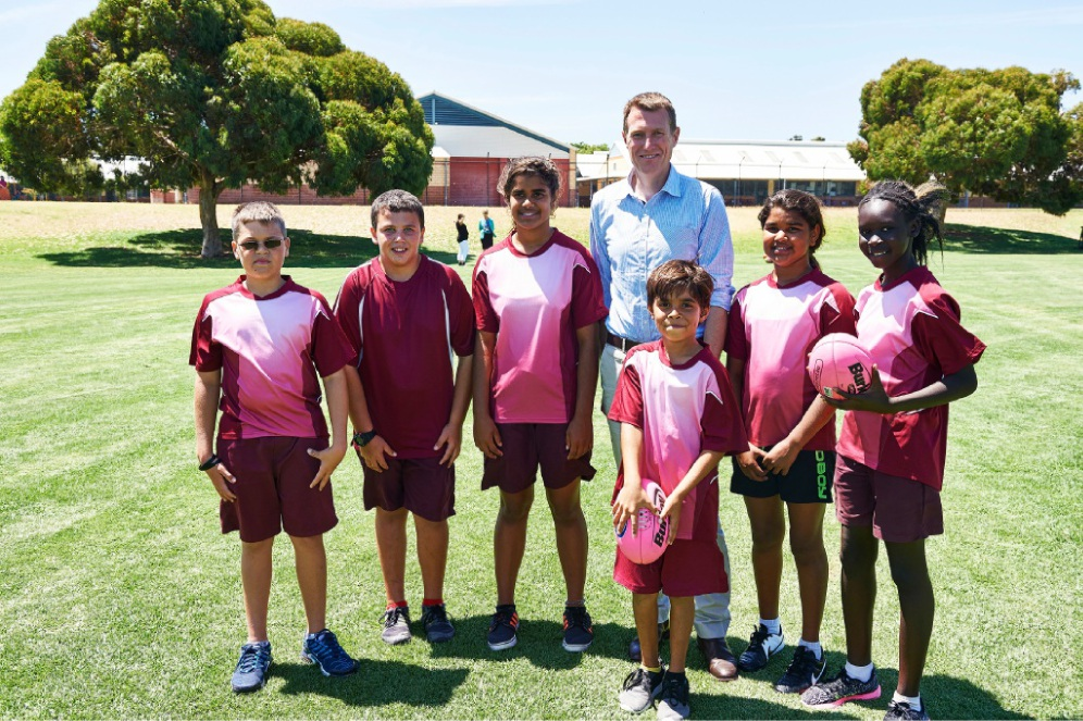 Christian Porter with Merriwa Primary School students Malcolm Yarran, Owen Hinton, Sheneka Shea, Brendan Kennedy, Violet Shea and Daruka Deng. Picture: Robert Fyfe.