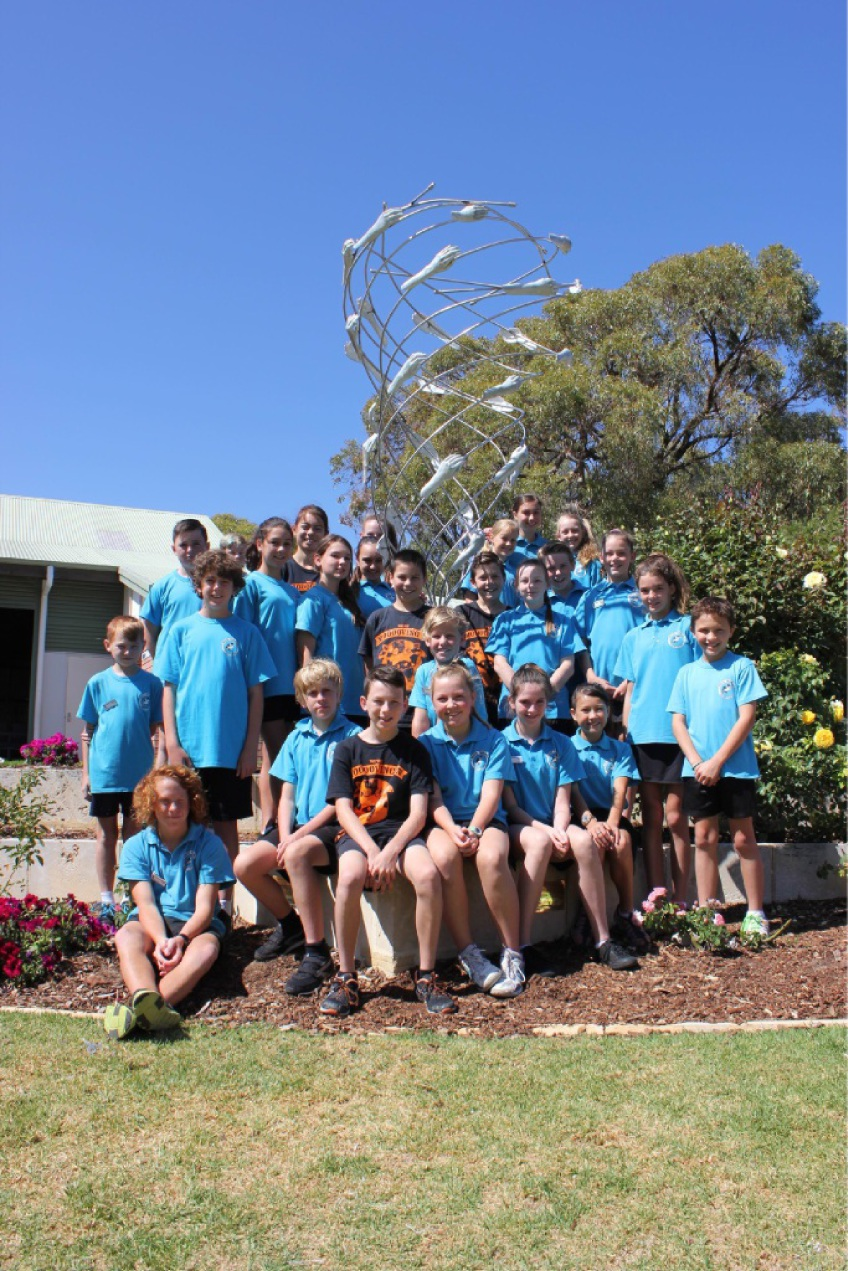 South Padbury Primary School Year 6 students with the sculpture they donated to the school.