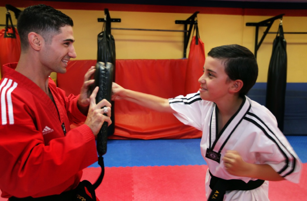 ATI director Rocco Capolingua with Stefan Tollis, whose condition has improved thanks to taekwondo.  Picture: Martin Kennealey        www.communitypix.com.au   d447756