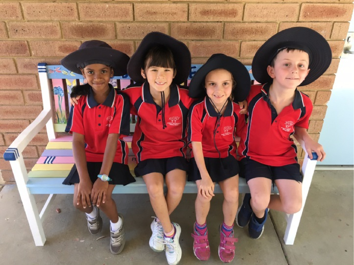 North Woodvale Primary School students Ainee Matheen, Lauren Berlandier, Amy Buehrig and Jake Perry-Smith enjoy the buddy bench.