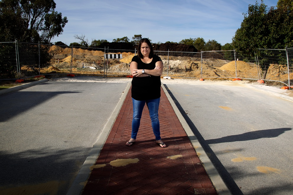 Kylie Beecroft at the proposed intersection of Celebration Boulevard and Neerabup Road. Picture: Marie Nirme         d452318