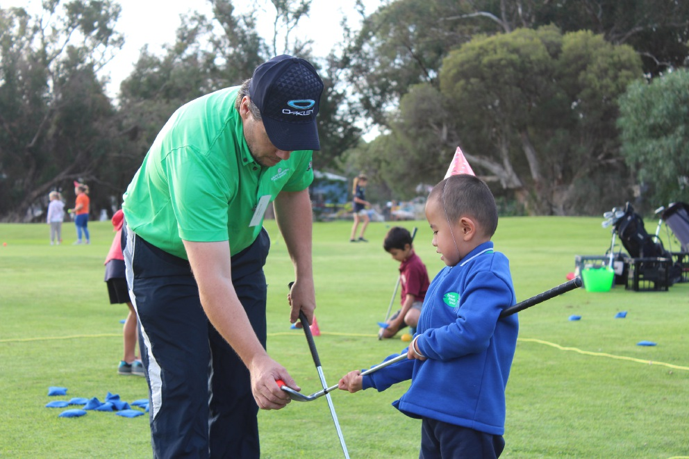 Coach Brendan Rayner with Jane Yu. Carter Foreman perfects his putting.