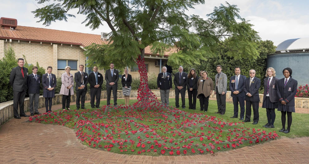 Students and guests at Kingsway Christian College's Anzac Day service with the artwork.