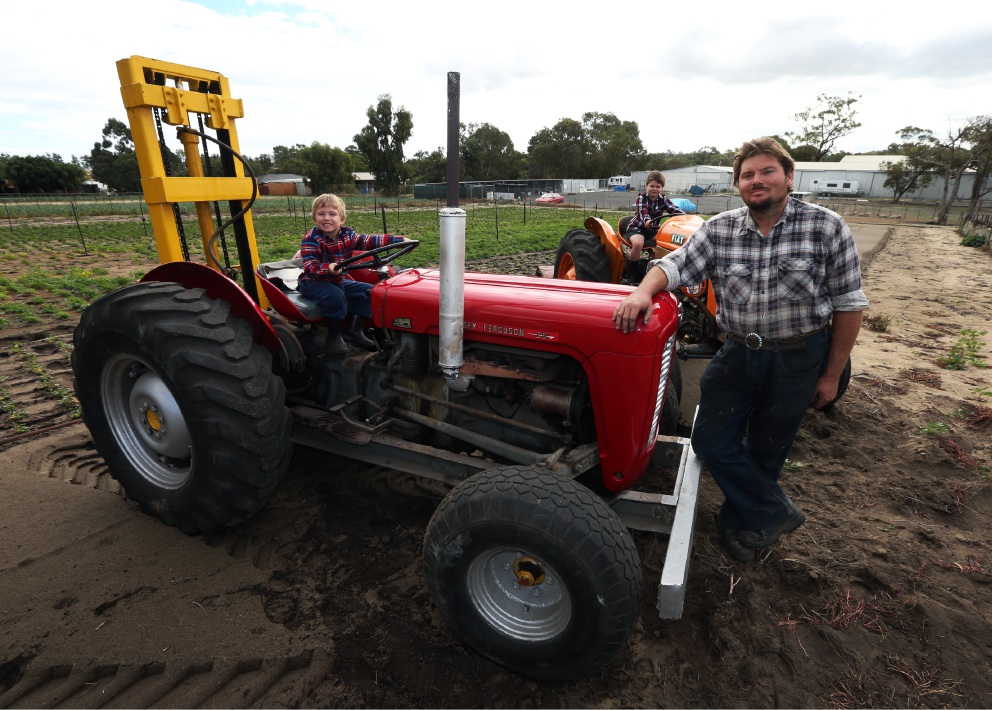 Brothers Markus (4) and Jonathon (5) with dad Duane Sain with their vintage tractors that will take part in the Heritage Vehicle and Machinery Day  Picture: Matt Jelonek  d453558