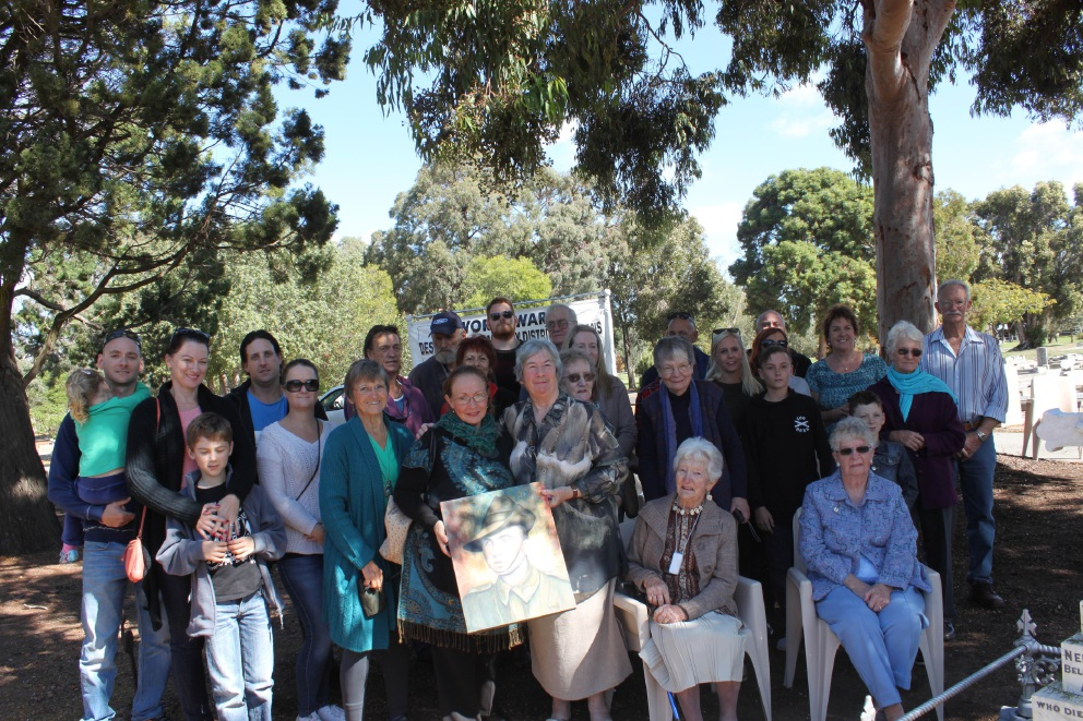 Above: Peg Thorn and Georgina Kosteszyn with a painting of Andrew Capps. Top left: Descendants of the Capps family gathered at |Pinjarra Cemetery for the memorial service.