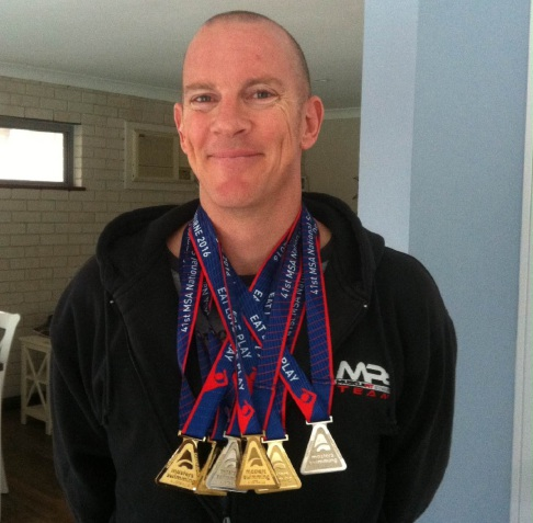 South Lake Dolphins swimmer Damien Eyre with his medals.
