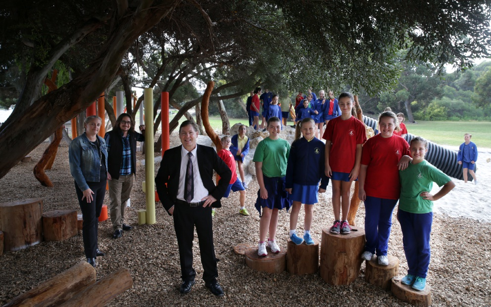 Sam Bean from the Mullaloo Beach Primary School P&C, teacher Adam Mosconi, principal Brian Davies and students in the new playground.  Picture: Martin Kennealey d453723