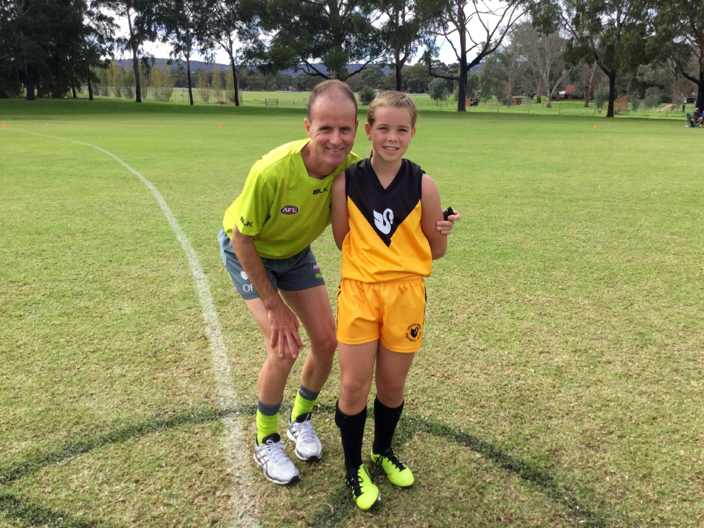 AFL umpire Dean Margetts with step- daughter Jaime Henry (10).