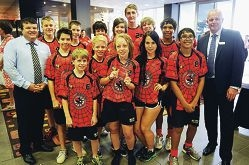 Community Newspaper Group editor-in-chief Greg Thomson and HBF managing director Rob Bransby with the Redbacks Floorball Club members. Picture: Marcus Whisson d395886